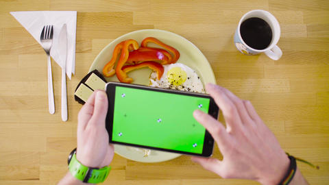 Male hands shooting an omelette with a tablet Live Action