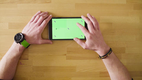 Male hand scrolling a tablet with green screen Live Action