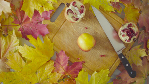 Autumn still life. Chef cutting a peach Live Action