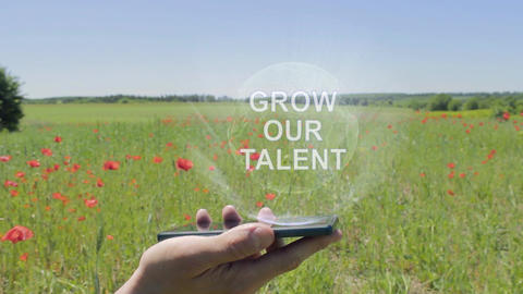 Hologram of Grow our talent on a smartphone Footage