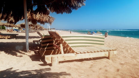 4k footage of wooden lounges on abandoned sea beach at windy day Live Action