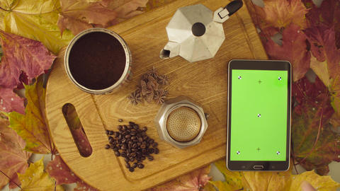 Autumn still life. Chroma key tablet and coffee Live Action