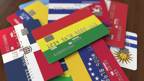 Many credit cards with different flags, emphasized bank card with flag of Footage