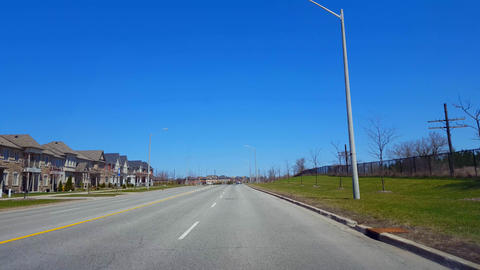 Driving Residential Road During Spring Day. Driver Point... Stock Video Footage