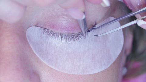 Cosmetologist begins to glue eyelashes Footage