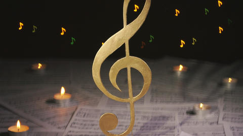 Musical notes on the table and treble clef Archivo