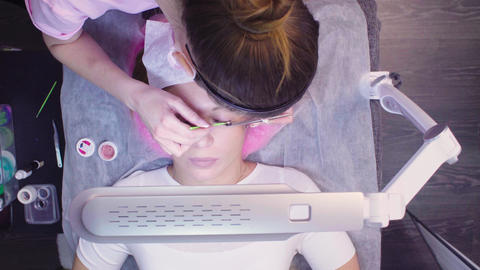 Master in a beauty salon removes the old eyelashes Footage
