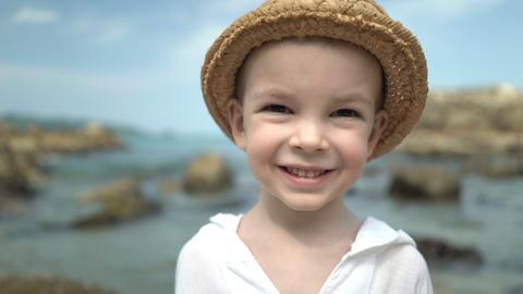 portrait cute boy in a straw hat on the beach Footage