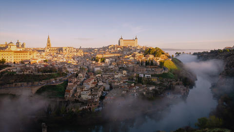 4K timelapse video at sunrise at Toledo, Spain. Old town cityscape with mist Footage