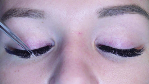 Woman eyes. Cosmetologist combing eyelashes Footage