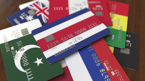 Many credit cards with different flags, emphasized bank card with flag of Costa Footage