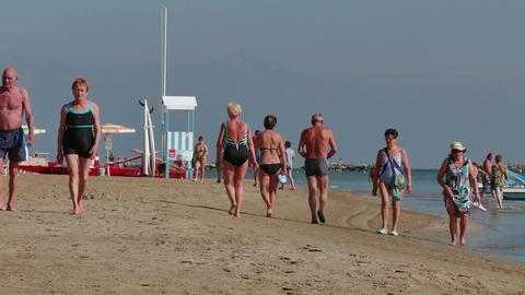 Seniors OId People Elderly Tourists Walking On Beach Near Sea Footage