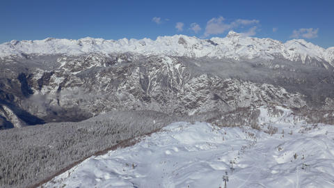Aerial - Panoramic, high angle view of ski resort on a sunny day Live Action