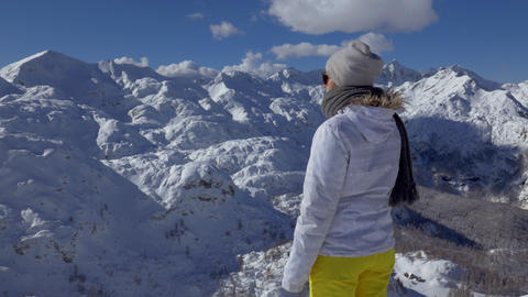 Mid shot - Young woman looking at the beautiful winter scenery Footage