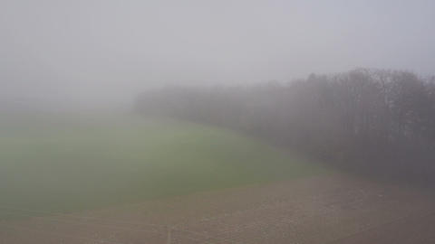 Aerial - Through the mist above the field Live Action