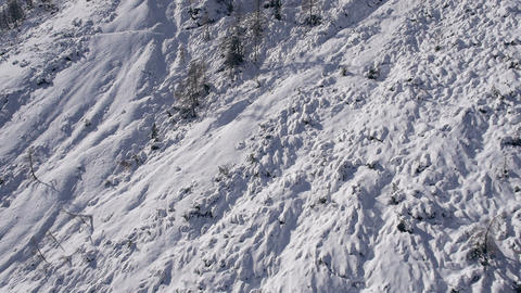 Aerial - Steep mountain terrain covered with snow Live Action