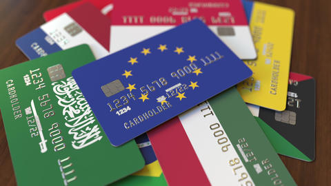 Many credit cards with different flags, emphasized bank card with flag of the Footage