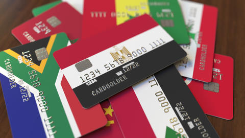 Many credit cards with different flags, emphasized bank card with flag of Egypt Footage