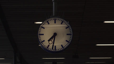 Round clock in the hall of the railway station Live Action