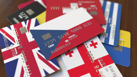 Many credit cards with different flags, emphasized bank card with flag of the Live Action
