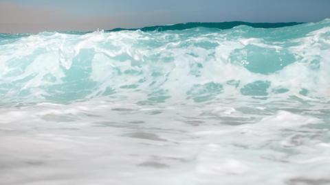 Slow motion 4k video of breaking big ocean wabes on the beach Footage