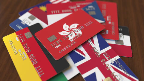 Many credit cards with different flags, emphasized bank card with flag of Hong Footage