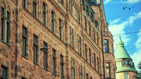 Old, historic ancient building of Stockholm, Sweden. Traditional architectural apartment and sky Footage