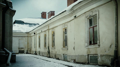 4K Snow and winter theme. Old, rustic building in winter time. Cold weather, snowfall and dark Live Action