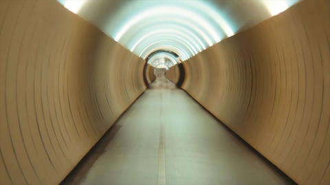 Empty yellow tunnel, walk way with beautiful perspective. Road with lights, nobody. Abstract footage Live Action