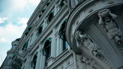 Old, historic baroque building with sculptures in Stockholm. Hotel building with green window Live Action