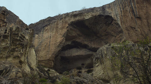 Birds Flying Near A Rocky Mountain Footage