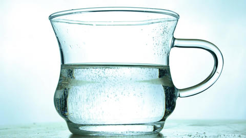 Mineral water, soda is fizzing on white background. Glass of healthy drink water and bubbles, fizzy, Footage