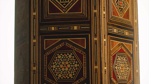 Ottoman's antique wooden platform is rotating with design. Decorative art, geometric shapes on Live Action