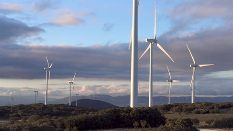Wind energy turbines on blue sky background, sustainable ecological energy Footage