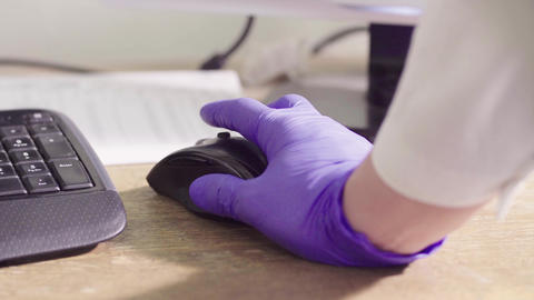 Hand of a scientist in protective gloves using mouse Footage