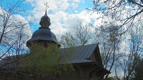 4K time-lapse. The wooden church in the old Russian style with a golden cross in Footage