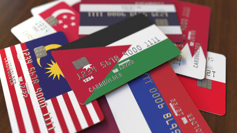 Many credit cards with different flags, emphasized bank card with flag of Jordan Live Action