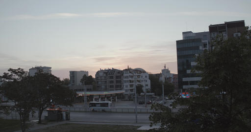 City bus passing through boulevard at sunrise in the morning GIF