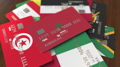 Many credit cards with different flags, emphasized bank card with flag of Live Action