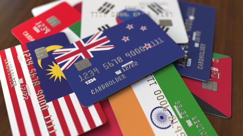 Many credit cards with different flags, emphasized bank card with flag of New Footage