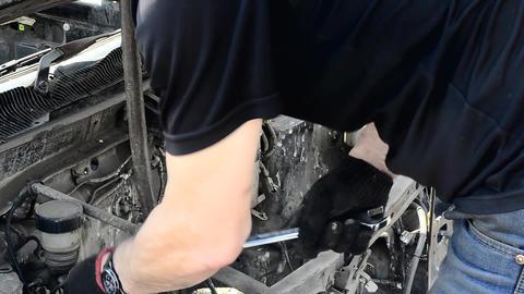 Auto mechanic removes car parts Live Action
