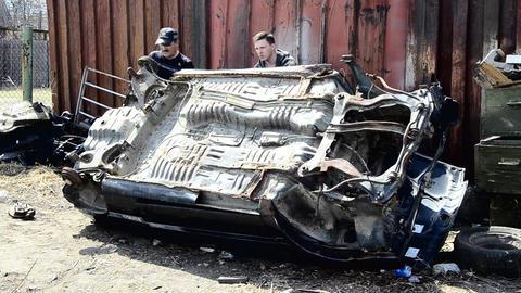 Two men turn over a broken car Live Action