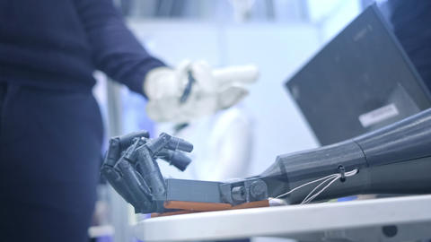 Robo-arm repeats the movements of the human hand. The plastic arm of a robot is Footage