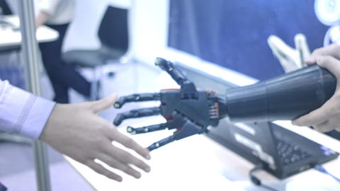Future is now. Male hand of young student scientist inventor shakes robotic arm Footage
