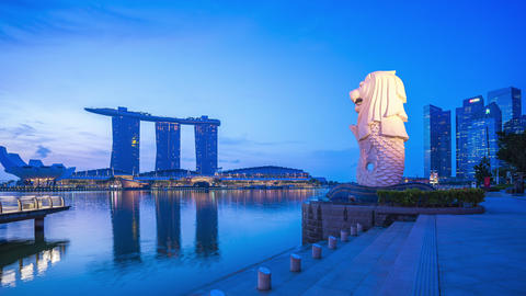 Singapore cityscape with Merlion night to day time lapse in Singapore Live Action