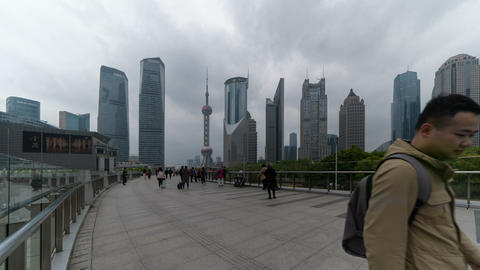 Time lapse of people walking on walkway in Shanghai Downtown, China. Financial district and business Live Action