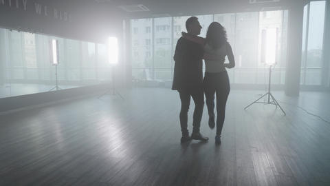 Handsome man dancing with his girlfriend in a dance studio Live Action