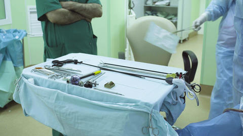 Surgical nurse preparing instrument for operation Live Action