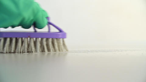 Worker Cleaning Floor with Detergent Using Violet Brush and Green Protective Footage