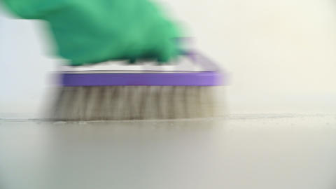 Worker Cleaning Floor with Detergent Using Violet Brush... Stock Video Footage